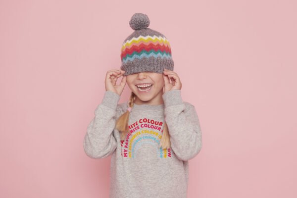 Girl wearing a Navigator Wolly hat and The Rainbow Sweatshirt in Grey by The Faraway Gang at Nurture Collective