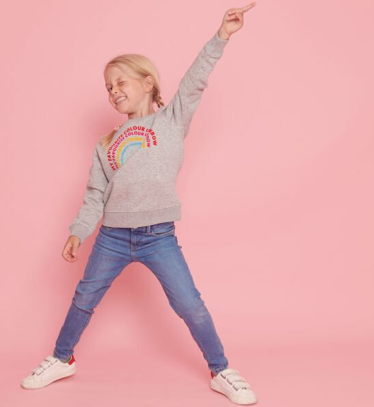 Girl Dancing in The Rainbow Sweatshirt in Grey by The Faraway Gang at Nurture Collective