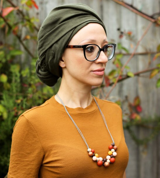 Woman wearing a Kodes necklace at Nurture Collective