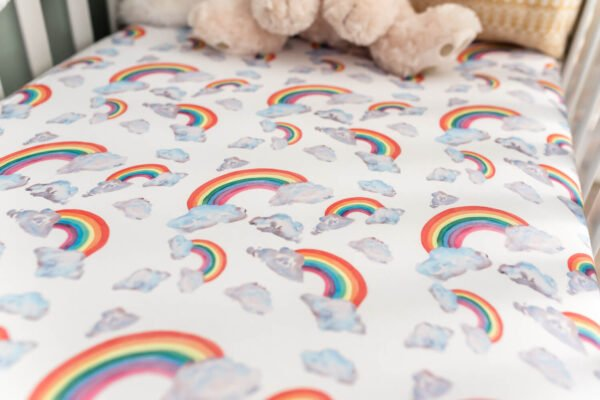 Rainbow on White Fitted Cot Sheet by Gilded Bird at Nurture Collective
