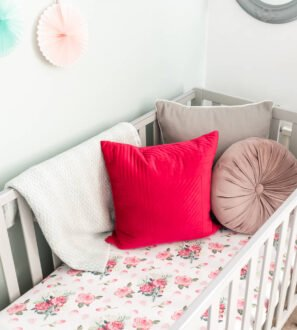 Pink roses Fitted Cot Sheet by Gilded Bird at Nurture Collective