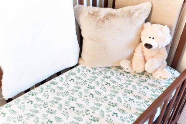 Lovely Leaves Green Fitted Cot Sheet by Gilded Bird at Nurture Collective