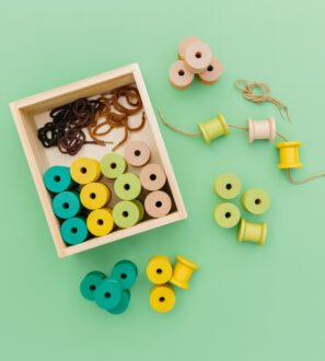 Wooden Threading Cotton Reels by Educational Advantage at Nurture Collective
